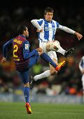BARCELONA - FEB 4: Mikel Aramburu (R) of Real Sociedad vies with Dani Alves(L) of FC Barcelona durin