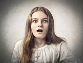 Teenage girl with astonished expression