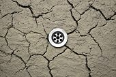 picture of water shortage  - Water drain in dry desert cranny soil - JPG