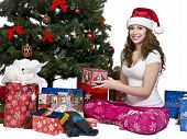 Portrait Of A Smiling Young Woman Holding Her Christmas Gift