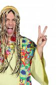 Enthusiastic man in a hippy costume