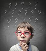 stock photo of nerd glasses  - Child with many question marks - JPG