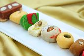 image of gulab  - Assorted colorful sweets of India - JPG