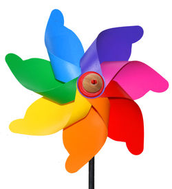 stock photo of color wheel  - Red yellowgreen and colored windmill toy white isolate - JPG