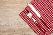 Knife And Fork With Red Checkered Napkin