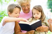 Grandmother Reading  A Book For Grandchildren