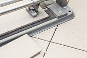 Close-up Of Tile-cutter With Laying Tiles