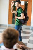 foto of say goodbye  - Vertical image of a student saying goodbye - JPG