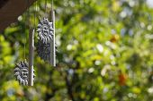 image of windchime  - weathered and well - JPG