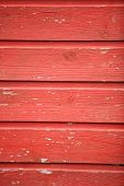 stock photo of woodgrain  - Background texture of old weathered red painted wooden planks with peeling paint and woodgrain - JPG