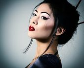 stock photo of geisha  - Young beautiful asian woman - JPG