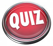 The word Quiz on a red round button or flashing light to illustrate a test, evaluation, exam or asse