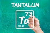 Hand drawing the symbol for the chemical element tantalum