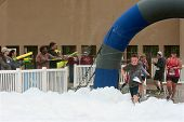 Runners Run Through Squirt Guns And Foam At 5K Race