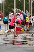 Man Throws Water Balloon In Group Fight After 5K Race