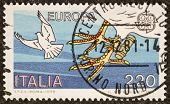 ITALY - CIRCA 1979: a stamp printed in Italy celebrates the European Idea showing the image of a carrier pigeon. Italy, circa 1979