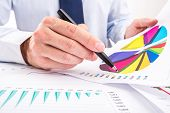 Businessman analyzing charts.