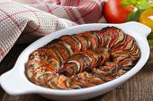 Ratatouille in a baking dish on a rustic table