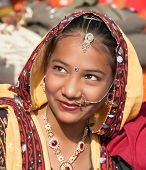 An Unidentified Girl In Colorful Ethnic Attire Attends At The Pushkar Fair. Pushkar, Rajasthan, Indi