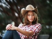 stock photo of cowgirl  - Soft portrait of sexy cowgirl - JPG