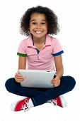 Cool Girl Kid Sitting On The Floor Holding Tablet Pc