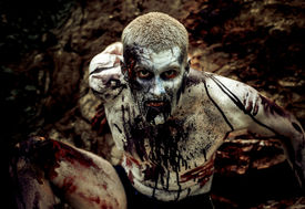stock photo of morbid  - young man with a zombie body painting - JPG