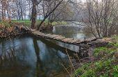 wooden bridge over the river