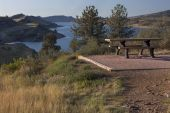 pic of horsetooth reservoir  - picnic table on shore of mountain lake  - JPG