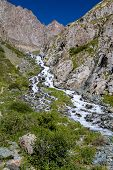 Cascade river in mountains of Tien Shan