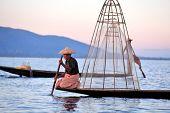 INLE LAKE, MYANMAR - DECEMBER 12, 2013: Fishermen at Inle Lake, Shan State, Myanmar  Intha people po