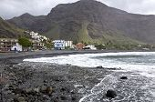 picture of tourist-spot  - Breaking waves at the pebble beach in the village La Playa on La Gomera - JPG