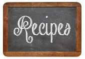 recipes word handwritten with white chalk on blackboard, isolated on white