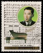 NORTH KOREA - CIRCA 1987: A stamp printed in North Korea shows Kim Ok Song (1916-1965), series Famous Composers, circa 1987