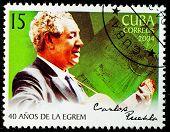 CUBA - CIRCA 2004: A stamp printed in Cuba shows Cuban singer, guitarist and composer Carlos Manuel Puebla,  circa 2004
