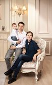 Young happy family with a baby indoors