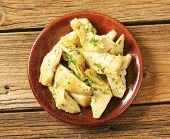 pic of artichoke hearts  - pickled artichoke hearts with herbs - JPG