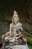 Buddhist Statue With A Third Eye In A Rock In The Ancient Forest