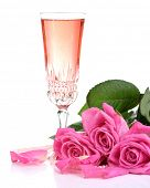 Composition with pink sparkle wine in glass and pink roses isolated on white