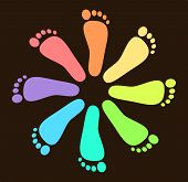 image of painted toes  - Foot prints in different colors arranged in a circular pattern over a brown background - JPG