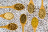Set Of Spices On White Leaf.