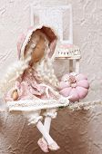 stock photo of tilde  - Textile doll is made by hand for children - JPG