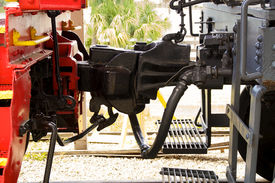 picture of caboose  - Detail of train coupling joining the engine to the caboose - JPG