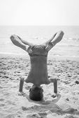 Boy Doing A Handstand On The Beach