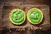 Tartlets With Spinach Cream For Halloween In The Form Of A Monster