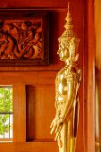 foto of vihara  - A golden statue of Buddha in a Buddhist Thai temple - JPG