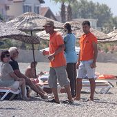 Turkish male waiters working on the beach
