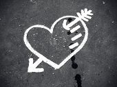 Abstract Love Symbol On Pavement