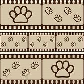 Retro background with film strips and pet paws