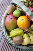 basket of fresh tropical fruits - fruits and vegetables