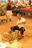 A turkish trader sorting his onions